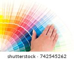 person chooses a color in the