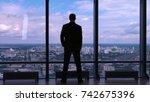 businessman standing near the... | Shutterstock . vector #742675396