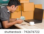man counting money sell online... | Shutterstock . vector #742676722