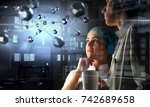 two interns working together | Shutterstock . vector #742689658