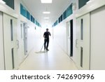 asian janitor man mopping floor ... | Shutterstock . vector #742690996