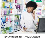 chemist writing on clipboard... | Shutterstock . vector #742700005