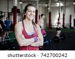 fit woman with arms crossed... | Shutterstock . vector #742700242