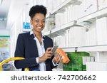 happy businesswoman scanning...   Shutterstock . vector #742700662