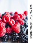 fresh raspberries and... | Shutterstock . vector #742757125