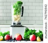 woman blending lettuce leaves ...   Shutterstock . vector #742793542
