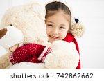 happy little girl holding teddy ... | Shutterstock . vector #742862662