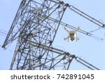 drone and transmission towers  | Shutterstock . vector #742891045