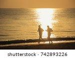 two men running with bare feet... | Shutterstock . vector #742893226