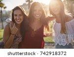 three happy girls standing...   Shutterstock . vector #742918372