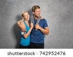 sports couple embracing over... | Shutterstock . vector #742952476