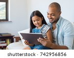 african father and smiling... | Shutterstock . vector #742956856