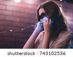 young caucasian woman in sheer... | Shutterstock . vector #743102536