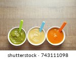 bowls with baby food on wooden... | Shutterstock . vector #743111098