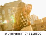 a couple enjoying the sunset in ... | Shutterstock . vector #743118802