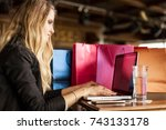 young female chats on laptop... | Shutterstock . vector #743133178