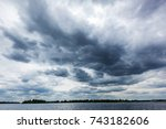 stormy clouds over the river ... | Shutterstock . vector #743182606