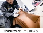 car wrapping specialist putting ... | Shutterstock . vector #743188972