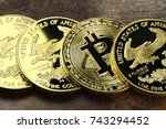 Small photo of Bitcoin in a row of 1 ounce American gold eagle bullion coins