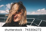 woman on boat deck in windy... | Shutterstock . vector #743306272