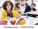 school children in classroom | Shutterstock . vector #743311942