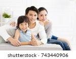 Happy Asian Family On Sofa In...