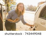 young woman is standing near... | Shutterstock . vector #743449048