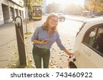 young woman charging an... | Shutterstock . vector #743460922