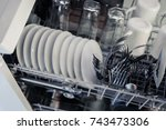 an open dishwasher with clean... | Shutterstock . vector #743473306