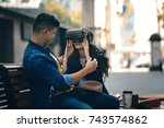 virtual reality tested by young ... | Shutterstock . vector #743574862