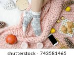 flatlay girl legs in a warm... | Shutterstock . vector #743581465