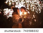 couple with sparklers | Shutterstock . vector #743588332