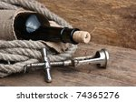 old corkscrew and bottle of... | Shutterstock . vector #74365276