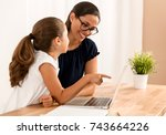 young mother helping her...   Shutterstock . vector #743664226