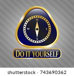 golden badge with compass icon ... | Shutterstock .eps vector #743690362