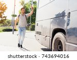 the guy runs after the bus that ... | Shutterstock . vector #743694016