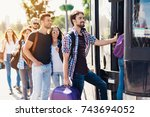 a group of tourists preparing... | Shutterstock . vector #743694052