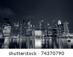 Modern city skyline with reflection on river in Singapore, Asia. - stock photo