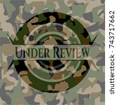 under review on camo texture | Shutterstock .eps vector #743717662