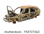 Burnt Out Car Isolated On Whit...