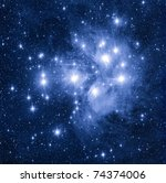 Reflecting nebula in open star cluster Pleyades - stock photo