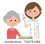 nurses and the elderly ... | Shutterstock .eps vector #743751586