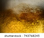 closeup of freshly poured gold... | Shutterstock . vector #743768245