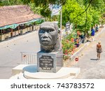 Small photo of SANGILAN, INDONESIA - AUGUST 22, 2011: Java Man head sculpture of Sangiran Museum in the Sangiran Early Man Site, Central Java, Indonesia.