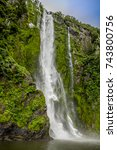 waterfall landscape | Shutterstock . vector #743800756
