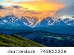 snow covered mountain peaks... | Shutterstock . vector #743822326