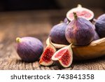 a few figs in a bowl on an old... | Shutterstock . vector #743841358