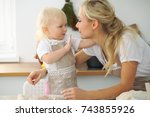 mother and little daughter are... | Shutterstock . vector #743855926