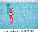woman in bikini relaxing on... | Shutterstock . vector #743862706