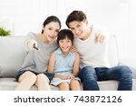 happy family watching tv in... | Shutterstock . vector #743872126